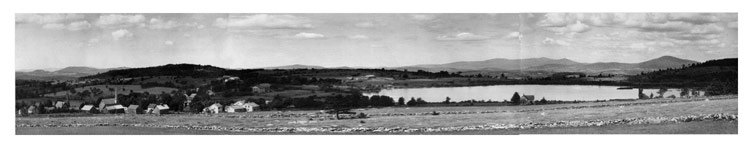 A black and white panoramic photo of Mechanicsville (now Belmont) and Jackson's Pond (now Star Lake).